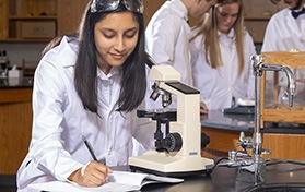 JCS student using microscope